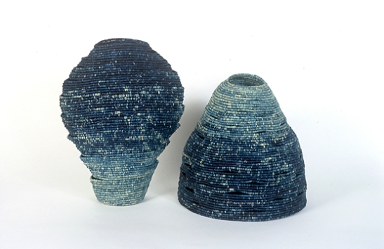 Barbara Shapiro. Un Homme and Une Femme are a paired set of coiled indigo dyed raffia; each supports the other, as they should.