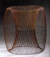Ueno Masao, Rotation of Ellipse Makes Two Transparent Drums, 2004. Bamboo (madake), rattan, lacquer, and gold powder. Photo by Susan Einstein.