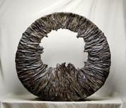 Nagakura Ken'ichi, Circle, 1990. Bamboo (madake), lacquer, powdered polishing stone, and clay. Photo by Mochizuki Akira.