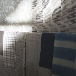 Detail image of a sample of textiles displayed at the Heath Ceramics Showrom, including block prints from the Galbraith & Paul collection