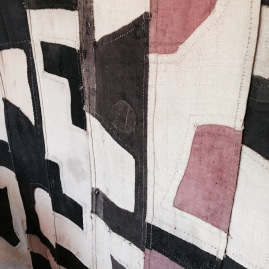 Detail of one of the large Kuba cloth tapestries hanging in Marcia Donahue's home