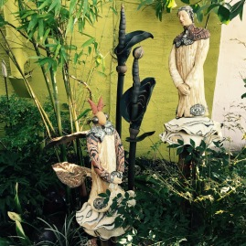 Marcia Donahue's Sculpture Garden figures thoughtfully placed throughout her outdoor gallery.