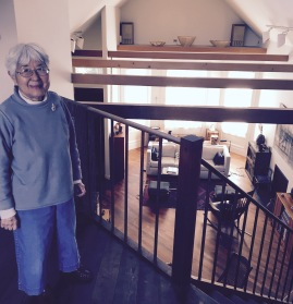 Kay Sekimachi standing in her beautiful sun lit studio space in her Berkely home