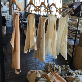 Matt Dick's collection of Uniform Aprons hanging in his Studio Showroom