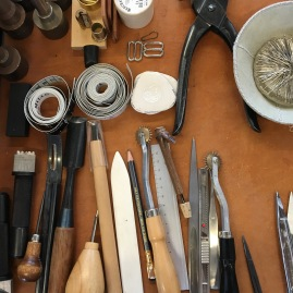 Matt Dick's tools of the sewing trade laid out nearby one of the cutting tables in his studio work space