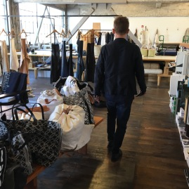 Founder of Small Trade Company, Matt Dick, walking across the floor of his Studio Showroom