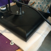 2: The fabric is put under the heat press machine with protective parchment paper cover