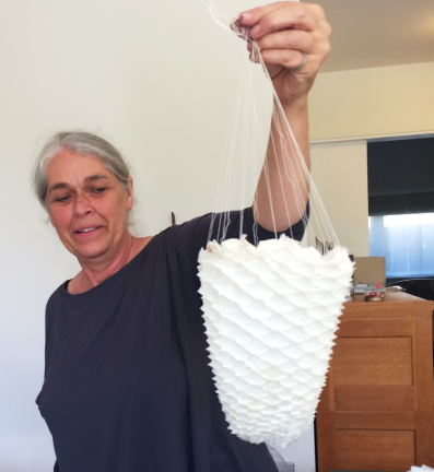 Elisa shows her 'Beehive' sculptural piece; hand stitched, pleated and heat set on polyster